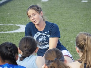 Two-time Olympian Julia Reinprecht speaks to players prior to running through drills during Upper Perkiomen's practice on Thursday. (Thomas Nash - Digital First Media)