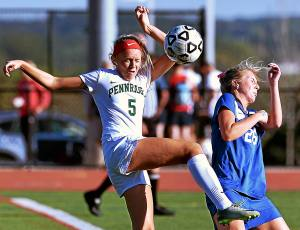 Bob Raines--Digital First Media Pennridge's Molly Groff beats Central Bucks South's Margot Centofanti on a header Oct. 5,2016.
