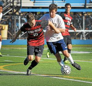 Gene Walsh — Digital First Media Wissahickon's Trey Schwartz battles Hatboro Horsham's Nick Hatzenbeller for the ball October 10, 2016.
