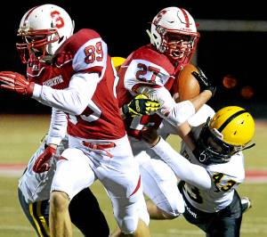 Bob Raines--Digital First Souderton running back Brandon Taragna is brought down by two Central Bucks West defenders as he tries to follow James Malm Oct. 28, 2016.