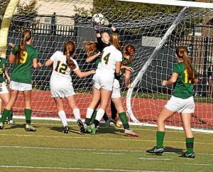 Wood's Molly Fleming makes a leaping save in traffic on Saturday against LC in the PCL Championship.