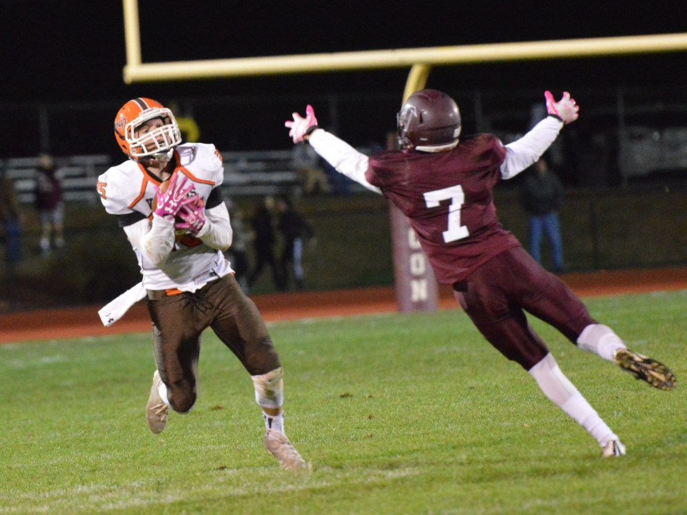 Perkiomen Valley's Justin Jaworski hauls in a 54-yard pass from Stephen Sturm in front of a Pottsgrove defender during the second half. (Sam Stewart - Digital Firs Media)