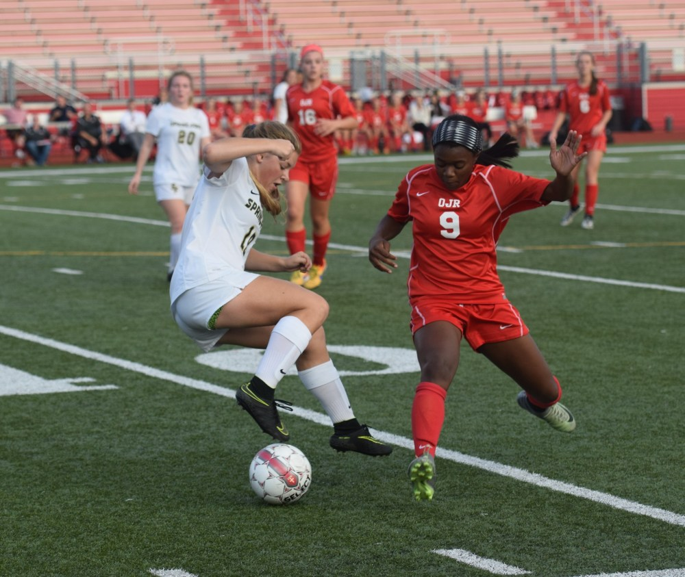 Molly McHarg pulls ball back against pressure of Mahogany Willis. (Austin Hertzog - Digital First Media)
