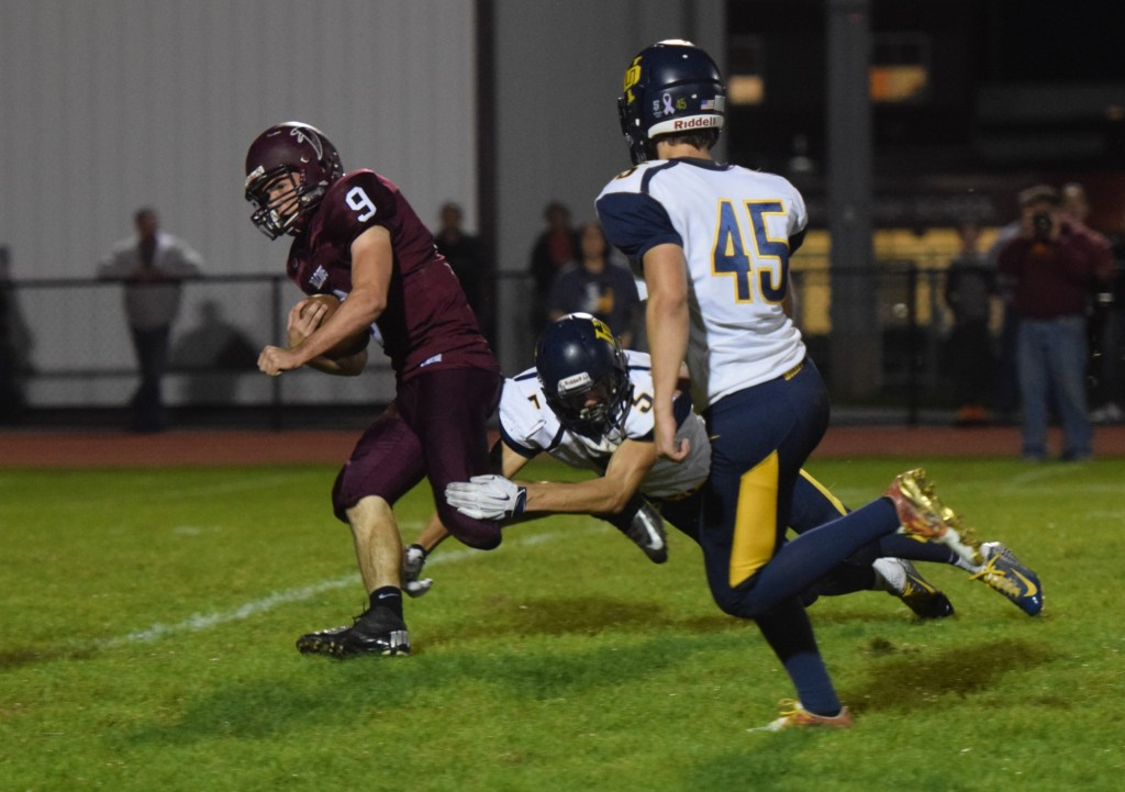 Pottsgrove quarterback Ryan Finn breaks into the secondary on a carry as Upper Perkiomen's Ryan Kendra makes the touchdown-saving tackle. (Austin Hertzog - Digital First Media)