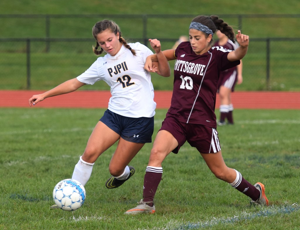 Pope John Paul II's Carson Tracy, left, and Pottsgrove's Dalia Abbas battle for the ball during Thursday's PAC girls soccer game. (Austin Hertzog - Digital First Media)