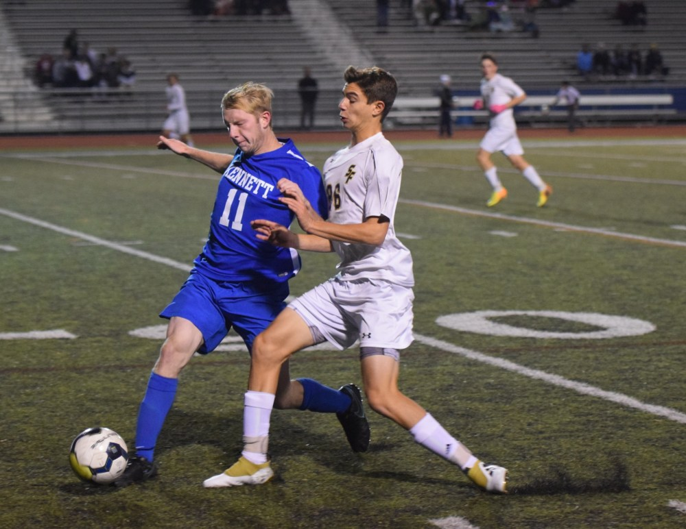 Kennett defender Ryan McMillen and Spring-Ford forward Michael Hyduke battle for the ball along the sideline. (Austin Hertzog - Digital First Media)