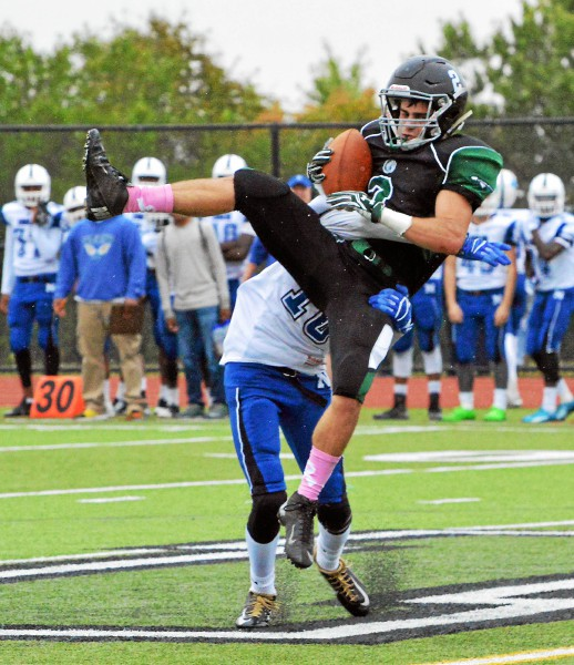 Methacton's Tremain Willson hauls in a pass in front of a Norristown defender on Saturday. (Debby High - Digital First Media)