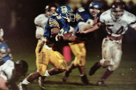 Downingtown's Arlen Harris picks up yardage during a 61-20 win over West Chester Henderson in the 1996 season finale. (AMY DRAGOO - DIGITAL FIRST MEDIA FILE)