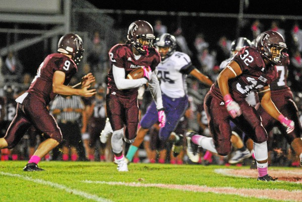 Pottsgrove's Rahsul Faison looks for a running lane Friday against Phoenixville. (Barry Taglieber - For Digital First Media)