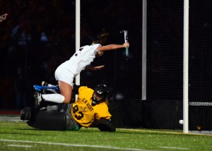 Emma McGillis tumbles over Laura Kubit after scoring on of her three goals