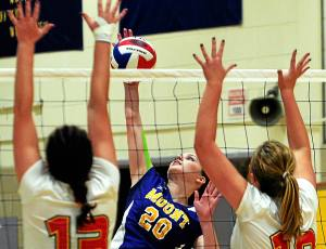 Bob Raines--Digital First Media Elizabeth Thomas (Mount Saint Joseph's) goes up to spike the ball past Gabrielle Greene and Olivia Guinther and Lizzy Ferguson(Gwynedd Mercy)  Nov. 1, 2016.