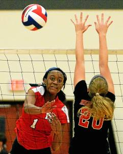 Bob Raines-Digital First Media Corrine Kalala (Plymouth Whitemarsh) spikes the ball Limdsey Heisey (Hempfield) Nov. 8, 2016.