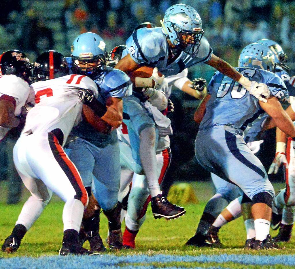 Bob Raines--Digital First Media Ricky Johns (North Penn) breaks a tackle as he fights his way through a hole in the Coatesville line Nov. 18, 2016.