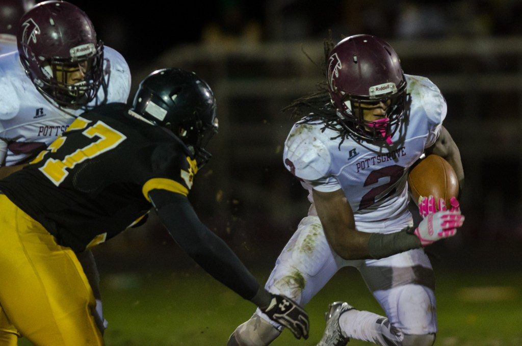 Pottsgrove's Rahsul Faison, right, gets around an Interboro tackler as he did all night in a 27-26 Pottsgrove win in overtime of the District 1 Class 4A final. (Digital First Media/Rick Kauffman)