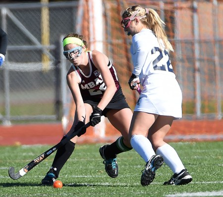 Bonner & Prendergast's Riley Dolan, left, tries to get around Merion Mercy's Jaime Natale Saturday. Natale recorded a hat trick as the Golden Bears ousted the Pandas, 4-0, in the PIAA Class 2A quarterfinals. (Digital First Media/Pete Bannan)