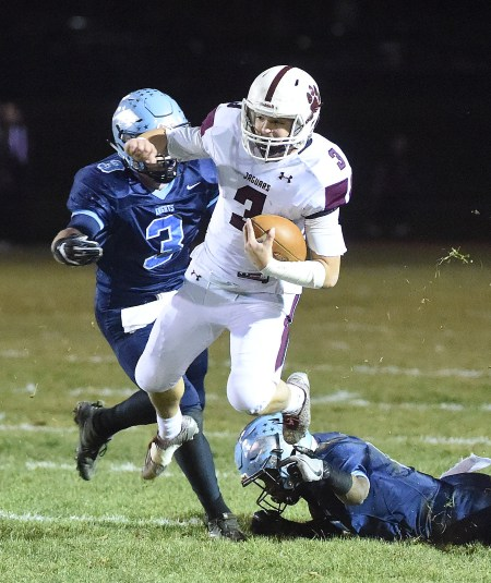 Garnet Valley's Jacob Buttermore, who rushed for over 1,000 yards this season, fights to pick up ground against North Penn in Friday night's District 1 Class 6A final. (Digital First Media/Pete Bannan)