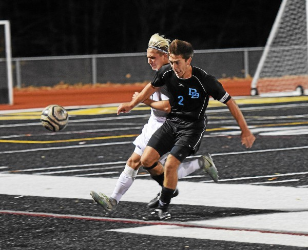 Daniel Boone's Matt Lambert ushers the ball out of play in the late stages against Dallas. (Austin Hertzog - Digital First Media)