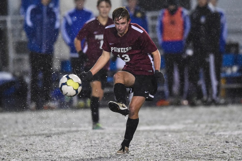 Blaise Milanek (13) of Conestoga passes the ball in the snow against ELizabethtown in the PIAA Class 4A boys soccer championship at Hersheypark Stadium in Hershey, PA on November 19, 2016. Mark Palczewski | Special to PA Prep Live.