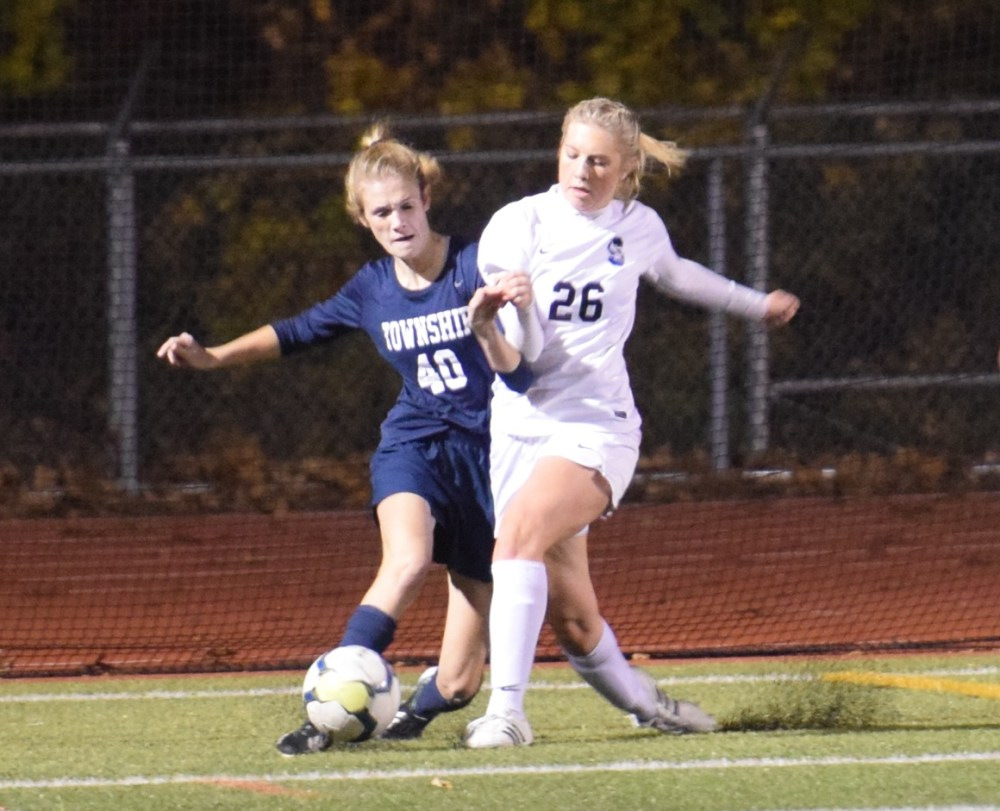 Central Bucks South's Margot Centofanti (26) knocks the ball away from Manheim Township's Sofia Gish during a PIAA Class 4A semifinal on Nov. 15 at Spring-Ford. (Austin Hertzog - Digital First Media)