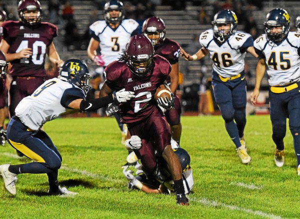 Pottsgrove's Rahsul Faison (2) rushes against Upper Perkiomen. Faison ran for 360 yards in the Falcons' win over the Indians in the first round of the 1-4A playoffs Friday. (Austin Hertzog - Digital First Media)