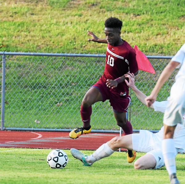 A Holy Ghost defender goes to ground and takes down Pottsgrove's Germann Larmond during their District 1-AAA boys soccer semifinal Wednesday. (Austin Hertzog - Digital First Media)