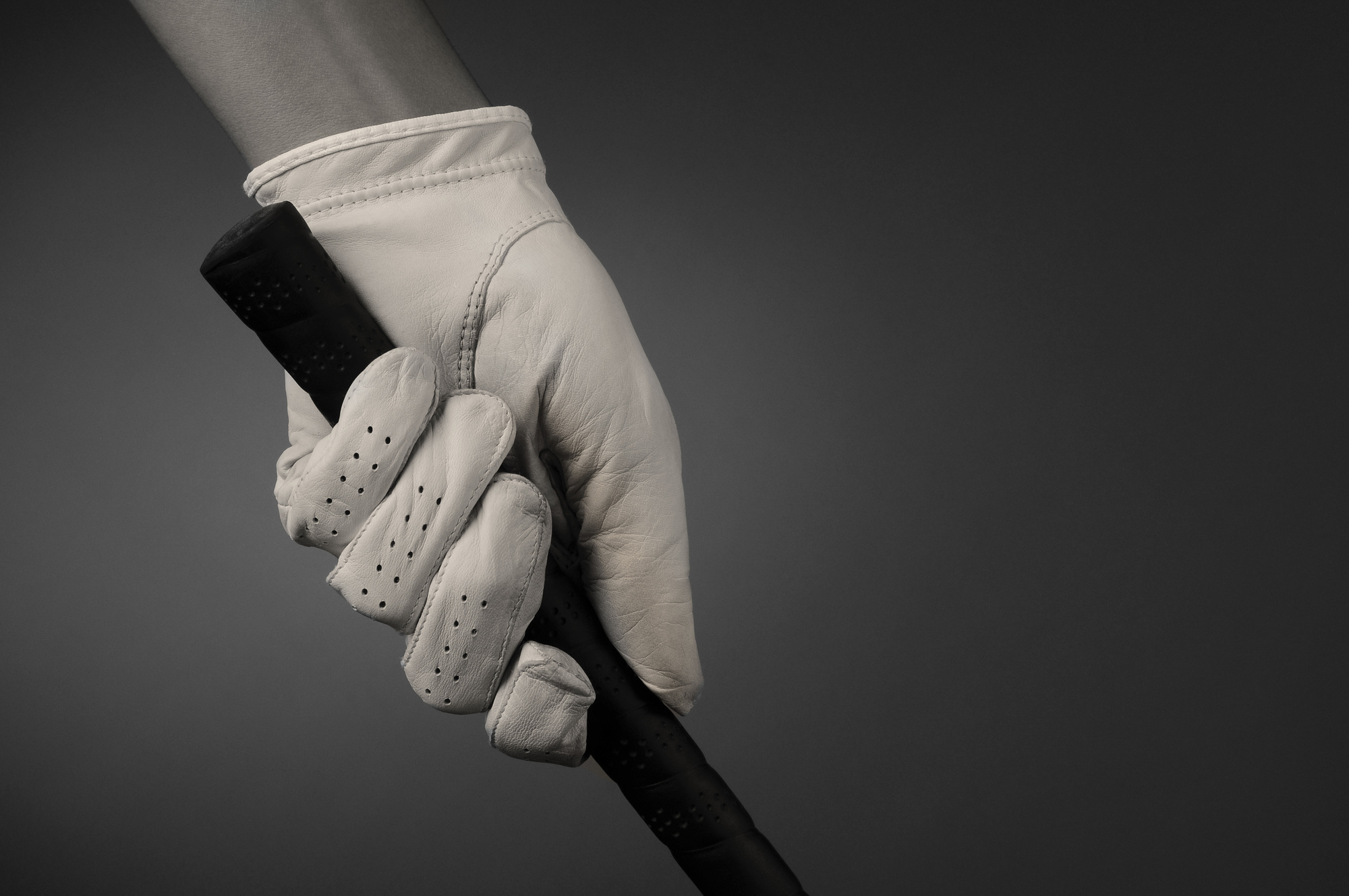 Closeup of a Golfers Gloved Hand on Club
