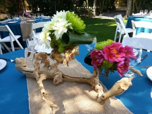 Driftwood and floral centerpieces. Why didn't I think of that?