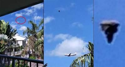 Un photographe a immortalisé un Humanoïde Volant au dessus d'un avion près d'un aéroport en Australie