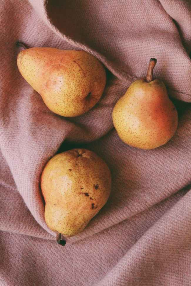 three pears on cloth