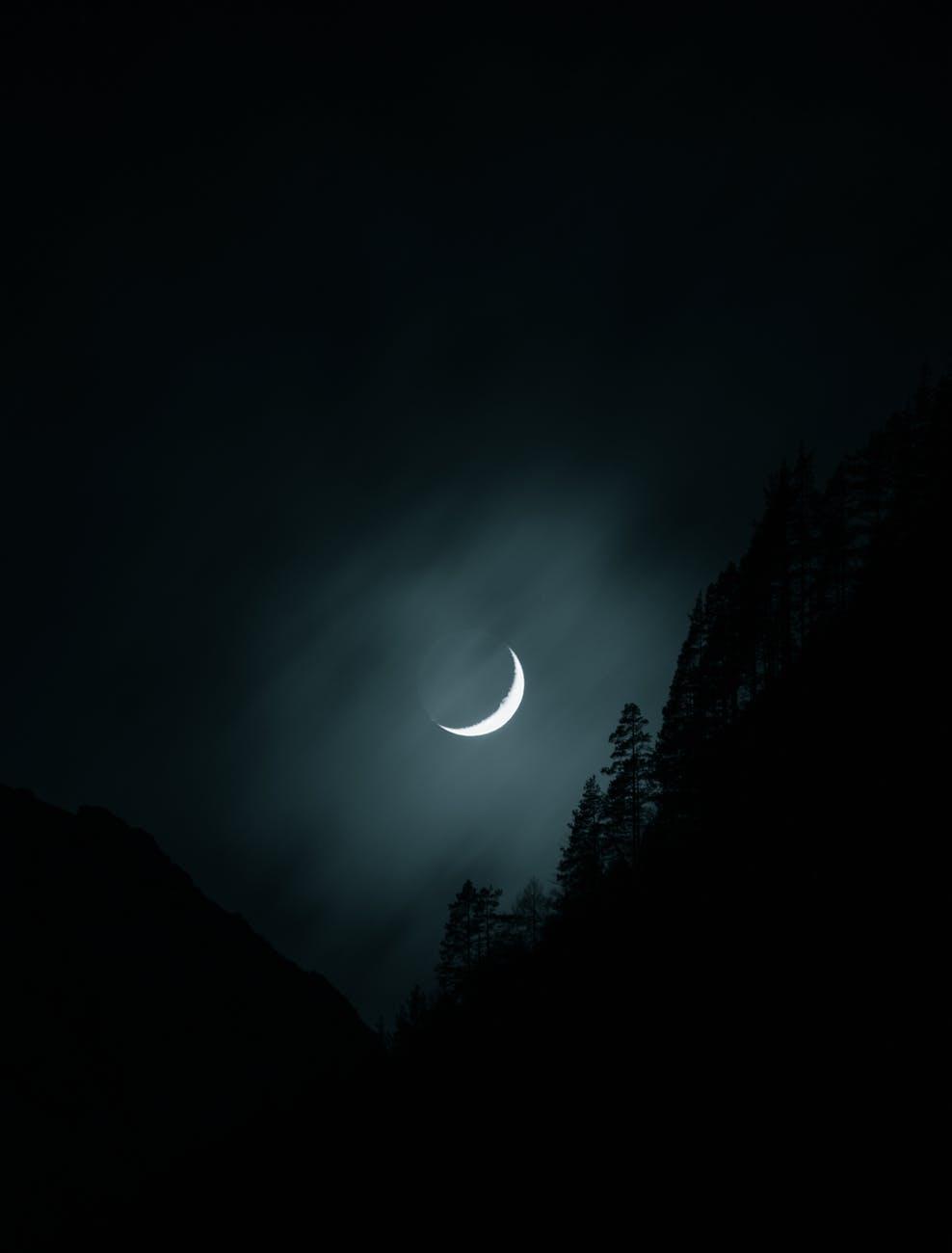 photo of moon on a dark sky