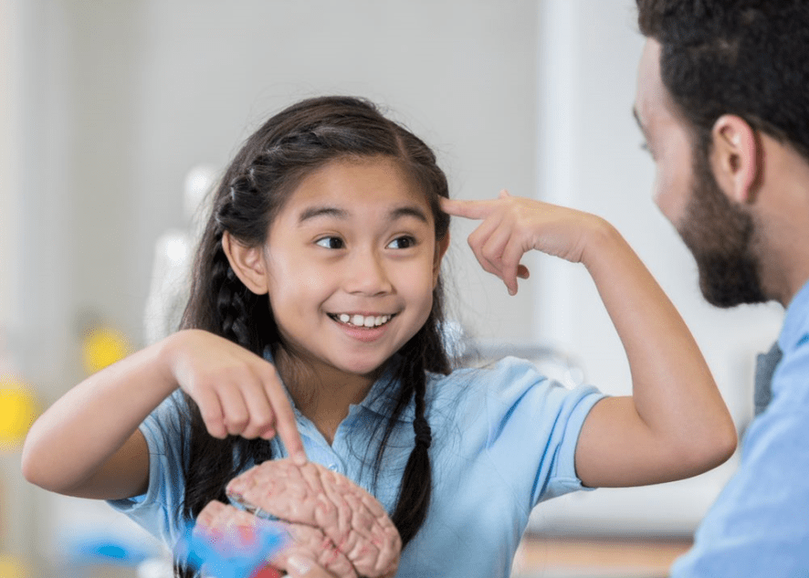 Young girl speaking with father