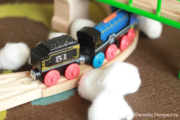 """Use cottonballs as """"snow"""" for some fun and creative train play!"""