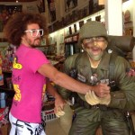Redfoo dancing with a fan