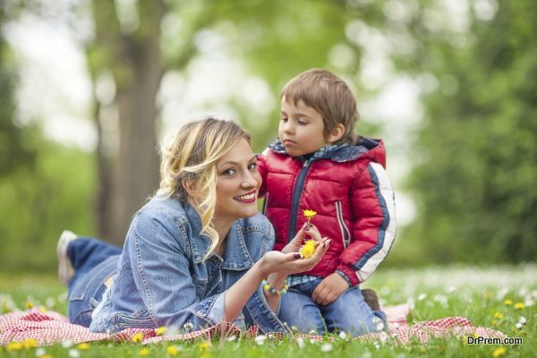 Boy Putting Flowers in Mother's Hair