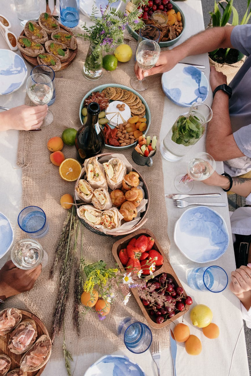 Plan a  potluck to save money during the holidays