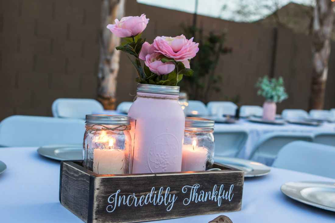 white candles on brown wooden crate