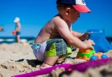boy playing beach toys
