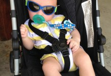baby wearing sunglasses in strollers