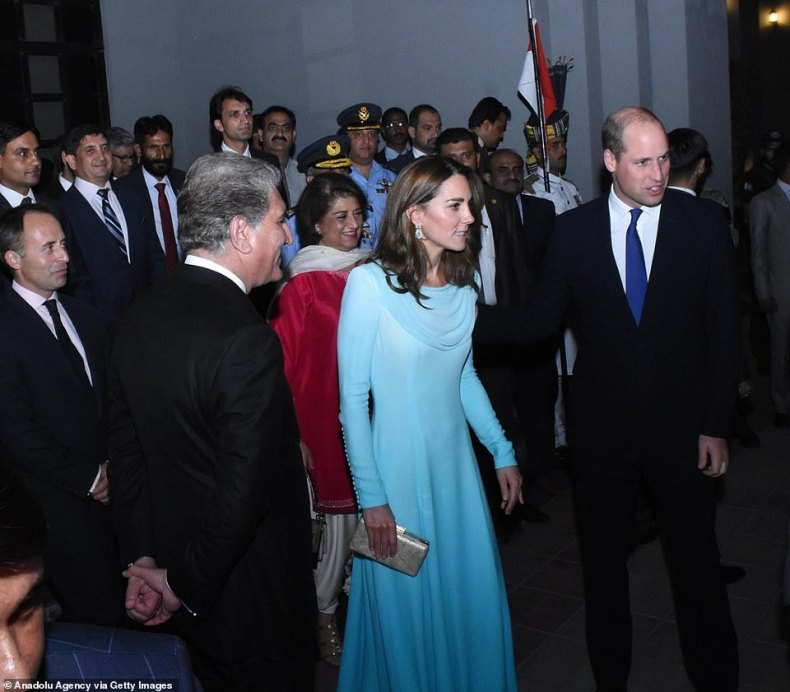 The Duchess of Cambridge (middle) and The Duke of Cambridge are welcomed yesterday eveningby Pakistani Foreign Minister Shah Mehmood Qureshi (left) at Nur Khan Airbase in Rawalpindi
