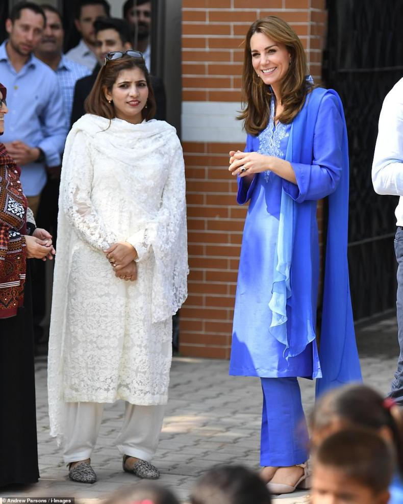 Kate watches the children playing in the playground at theIslamabad Model College for Girls in the Pakistani capital