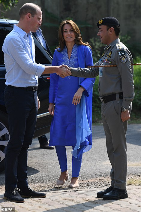 Thank you: William and Kate shake hands with a Pakistani security official to thank them for keeping them safe on their five-day tour of the country