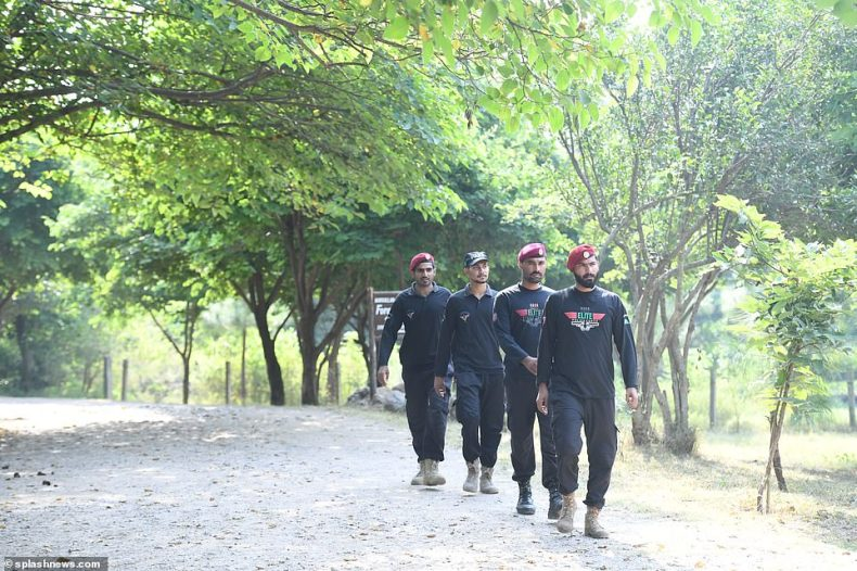 Security officials are pictured preparing for the couple to arrive at Margalla Hills in Pakistan for their next engagement