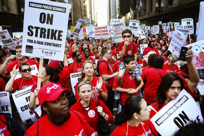 Thousands of Chicago public school teachers and their supporters march in front of the Chicago Public Schools (CPS) headquarters on September 10, 2012 in Chicago, Illinois.