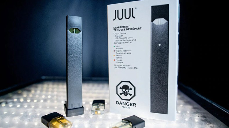 Juul starter kit with all the pieces on display.