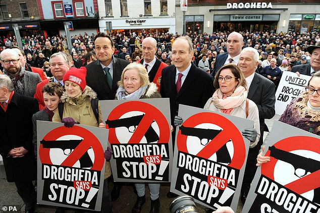 Taoiseach Leo Varadkar (centre left) and Fianna Fail leader Micheal Martin (centre right) during a rally in Drogheda, Co. Louth, to voice opposition to drug-related violence on Saturday
