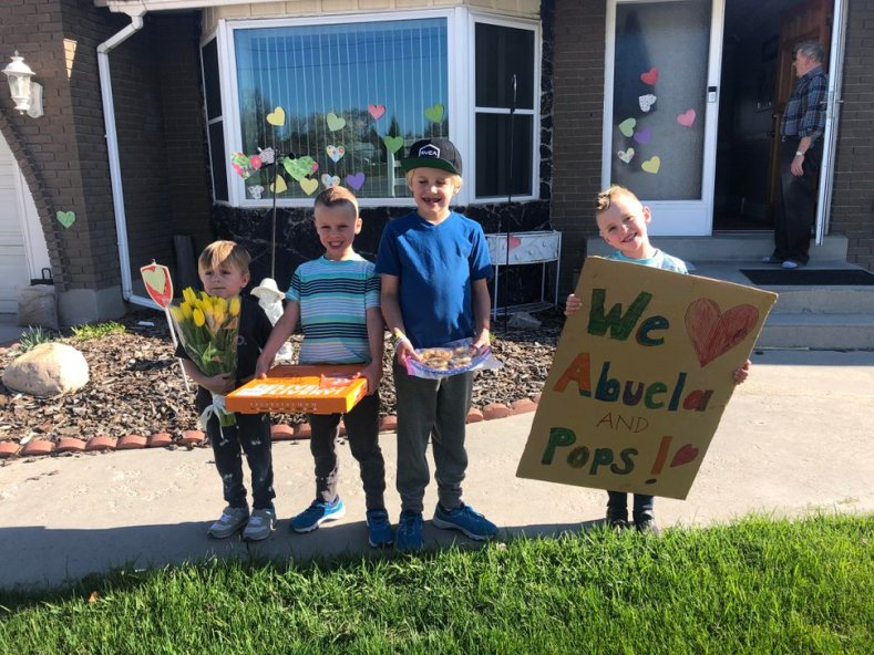 (Photo courtesy of Caisa Brown) The Brown boys, from left Taggart, 5; Crew, 8; Beckley, 10; and McKay, 8; stand in front of their grandparents' house in April 2020. Unable to have close contact with their grandparents because of COVID-19, they gave them a