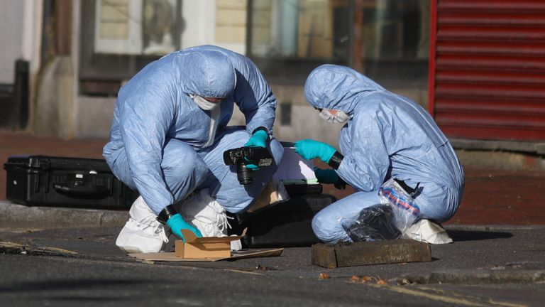 Forensic officers work near Forbury Gardens, in Reading town centre, the scene of a multiple stabbing attack which took place at around 7pm on Saturday leaving three people dead and another three seriously injured.