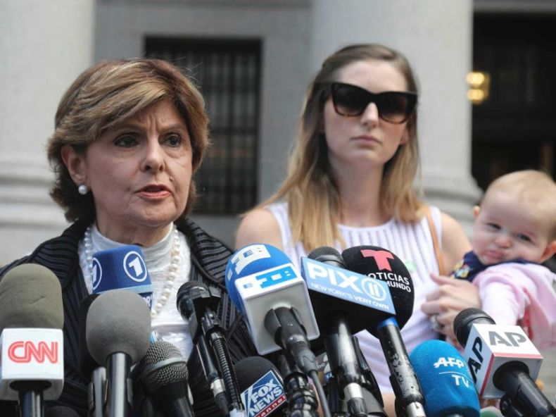 Attorney Gloria Allred, centre, flanked by two of her clients who have accused Jeffrey Epstein of sexual abuse