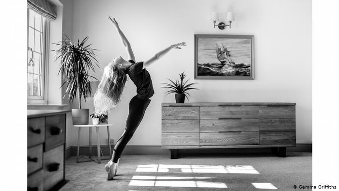 Photo from series 'Lockdown Ballet': Black and white photo of a young, slender figure with long blond hair, stretching on his tiptoes (Gemma Griffiths)