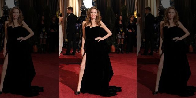 Angelina Jolie as she poses on the red carpet at the Hollywood & Highland Center Theatre during the 84th Academy Awards (Photo by Bob Riha, Jr./Getty Images)